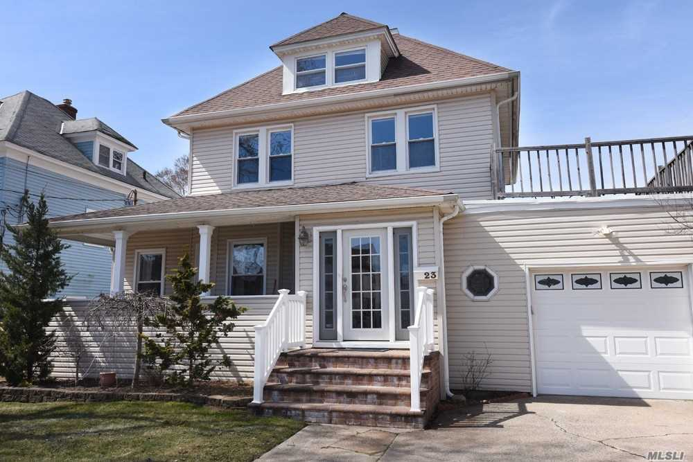 Located approx 1/2 mile to the LIRR, this lovely colonial offers a front porch, large entry, classic staircase, Victorian-era features, huge LR, formal DR w/ sliders to yard, gas cooking, & garage access to house. The second floor has a library nook, large master, two additional bedrooms, full bath, & stairs leading to the finished attic, the perfect place to play or work from home. The finished basement provides more space to play, w/laundry & storage. Huge yard with deck & lawn area.