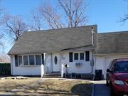 expanded Cape, 4 BR , 3 Baths, Updated Kitchen, Ceramic Tiles, Full basement w/OSE