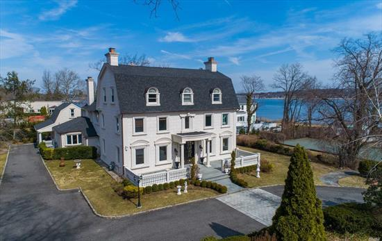 Elegant Colonial is perfectly situated on almost an acre of land with panoramic water view and is just a stones throw away from a private waterfront pool and tennis club. Three stories, completely renovated for gracious living detailed with elaborate moldings, exotic marble and three fireplaces.Finished basement.Entertain on a grand scale or enjoy as your private getaway. Great Neck Schools. Eligble for Shelter Bay Yacht Club Membership.Private Police. Immediate Occupancy
