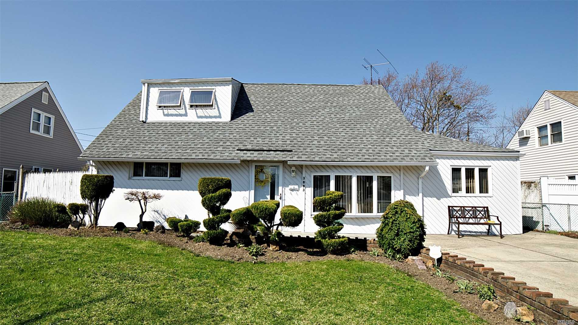 Lovely Cape features 4 bedrooms, 2 Full baths, Eat in Kitchen, Formal Dining Room, Huge den with two sky lights and sliding doors out to yard . Must See