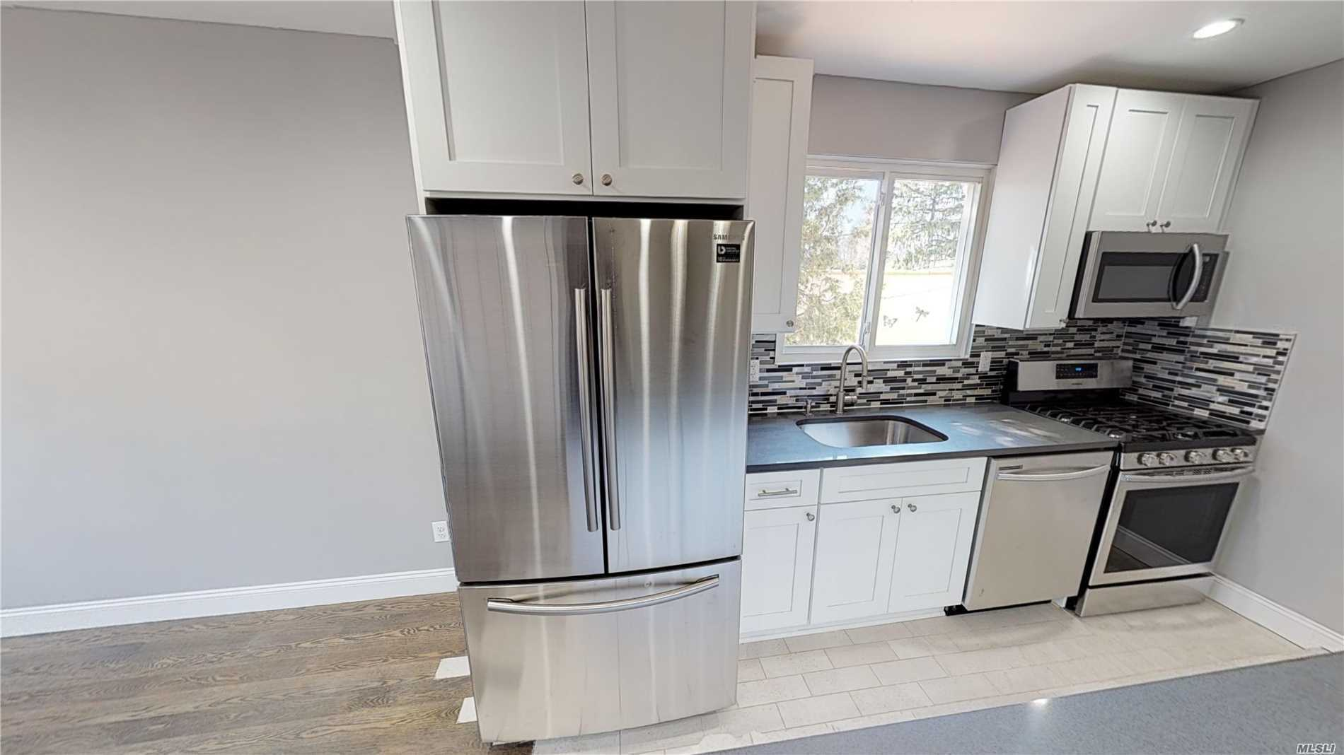 Completely Renovated, Beautiful, 2 Bedroom (Possible 3 Bedroom) 2 Bath Duplex with a Large Open Concept Kitchen, Private Oversized Yard and Plenty of Storage..... Quiet street. Close to all!