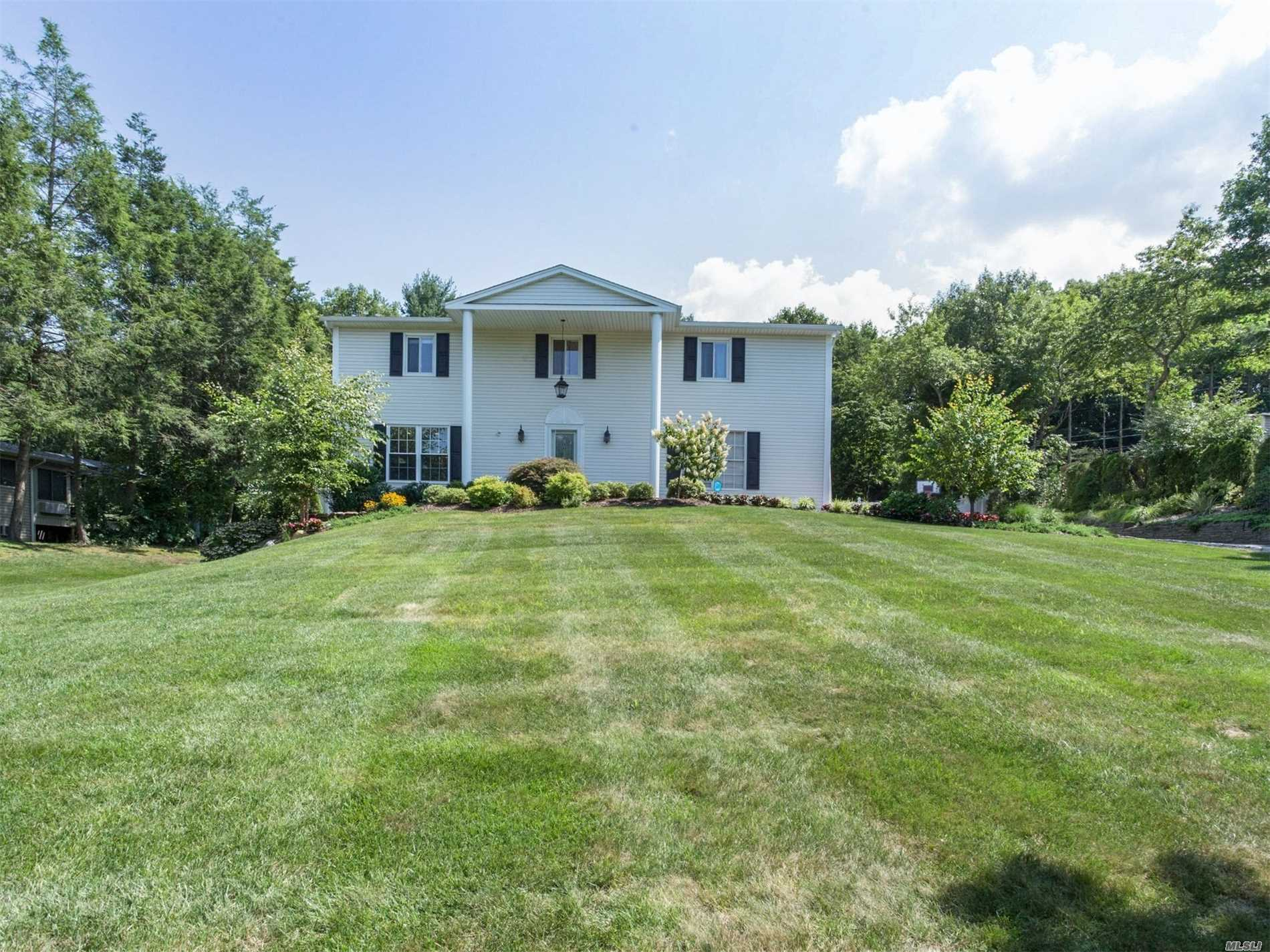 Exquisite Updated Colonial Situated on Top Of .58 Acres. Boosting 5 beds, 3.5 Baths & Hardwood Floors This Home Has It All. Gourmet Eik w/all The Extras, Gas Fireplace w/Built-Ins, Master Suite w/Wic & Radiant Heat Custom Bath. Full Basement w/OSE, In-Law Suite or Office w/Proper Permits. New Updates Include Heating, Electric, & Plumbing. The Yard Is Professionally Landscaped, Fenced, & Pool w/New Liner, Heater, Pump & Electric. No Expenses Were Spared!