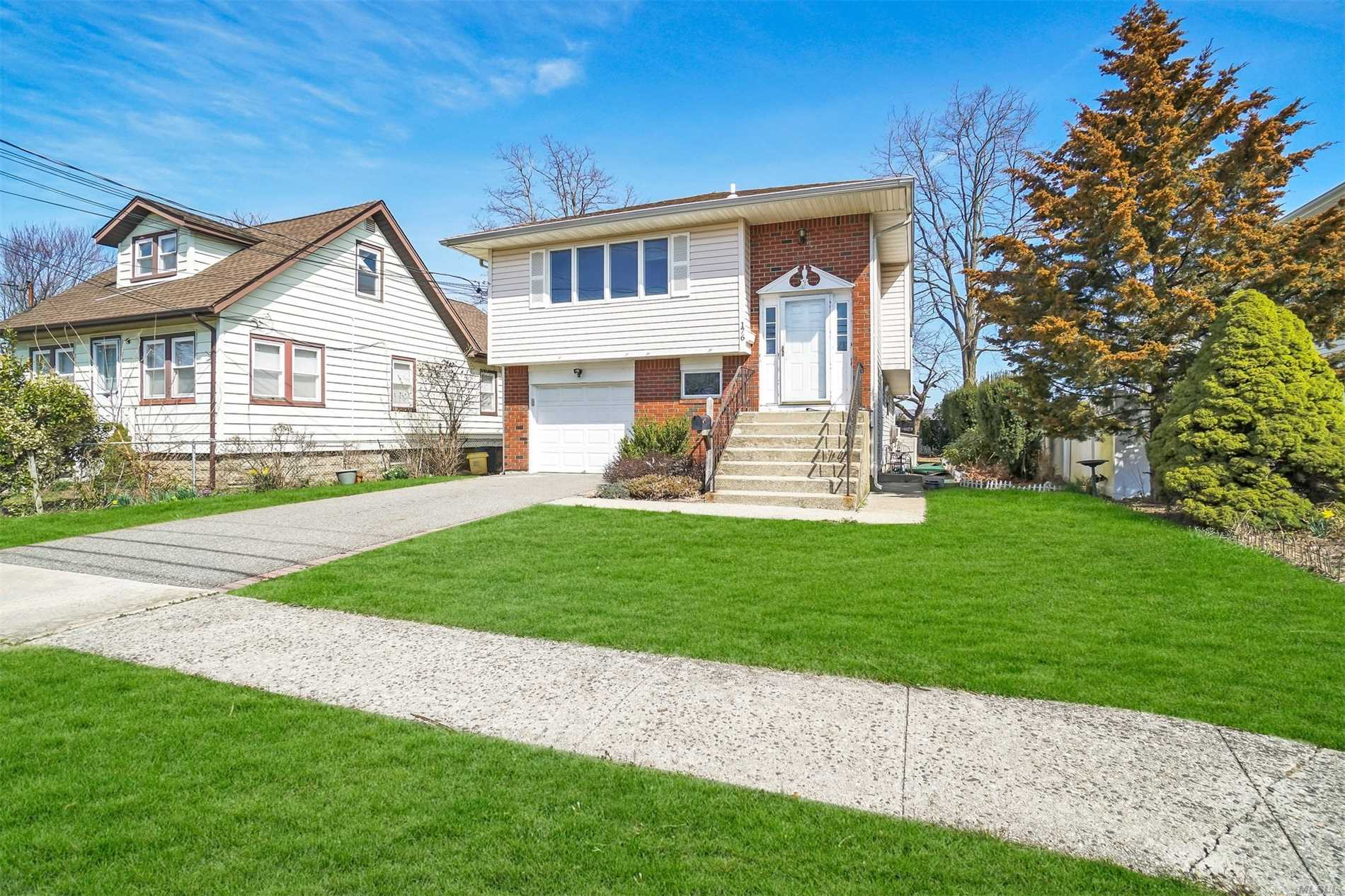 You must see this immaculate hi-ranch in prime Bethpage location with freshly painted and carpeted second level, updated kitchen and bath, gas cooking and heating, newer roof and siding, and close to main roads, shopping, and restaurants. Taxes are being grieved. Bethpage Schools.