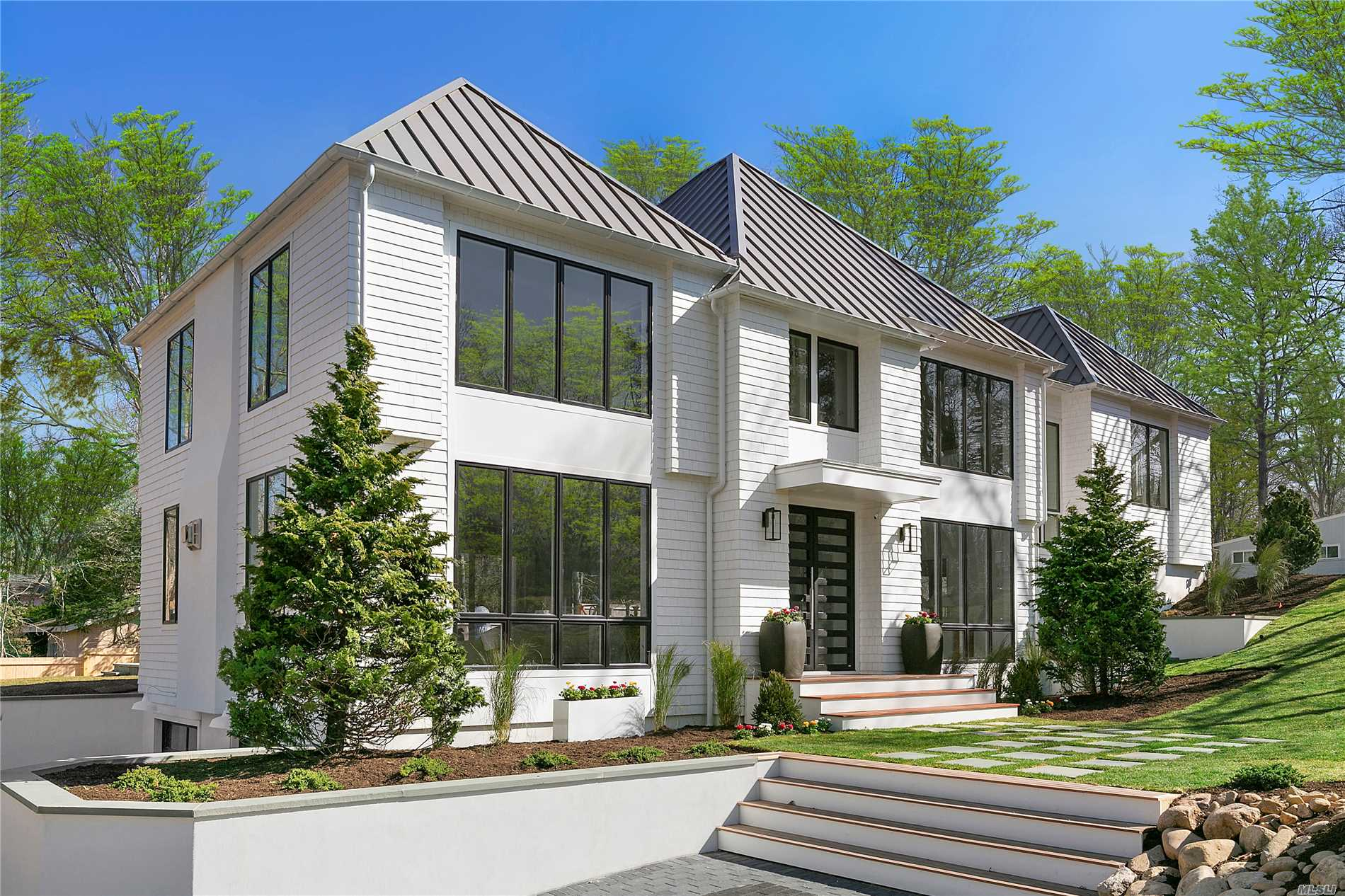 Situated in a private community within the Village of Sag Harbor, newly constructed 5 BR, 5.5 BTH 4, 000+ sf foot home. Main floor has open floor plan for living/Dining and easy entertaining, opens to sun filled yard with extensive bluestone decking, heated gunite salt water pool and large grassy areas beautifully landscaped. Upper level boasts Master bedroom Suite, 4 addt'l BR's all en-suite, waterworks fixtures throughout, Finished Lower level w/wet bar, oversized 2 car garage, Don't miss this!