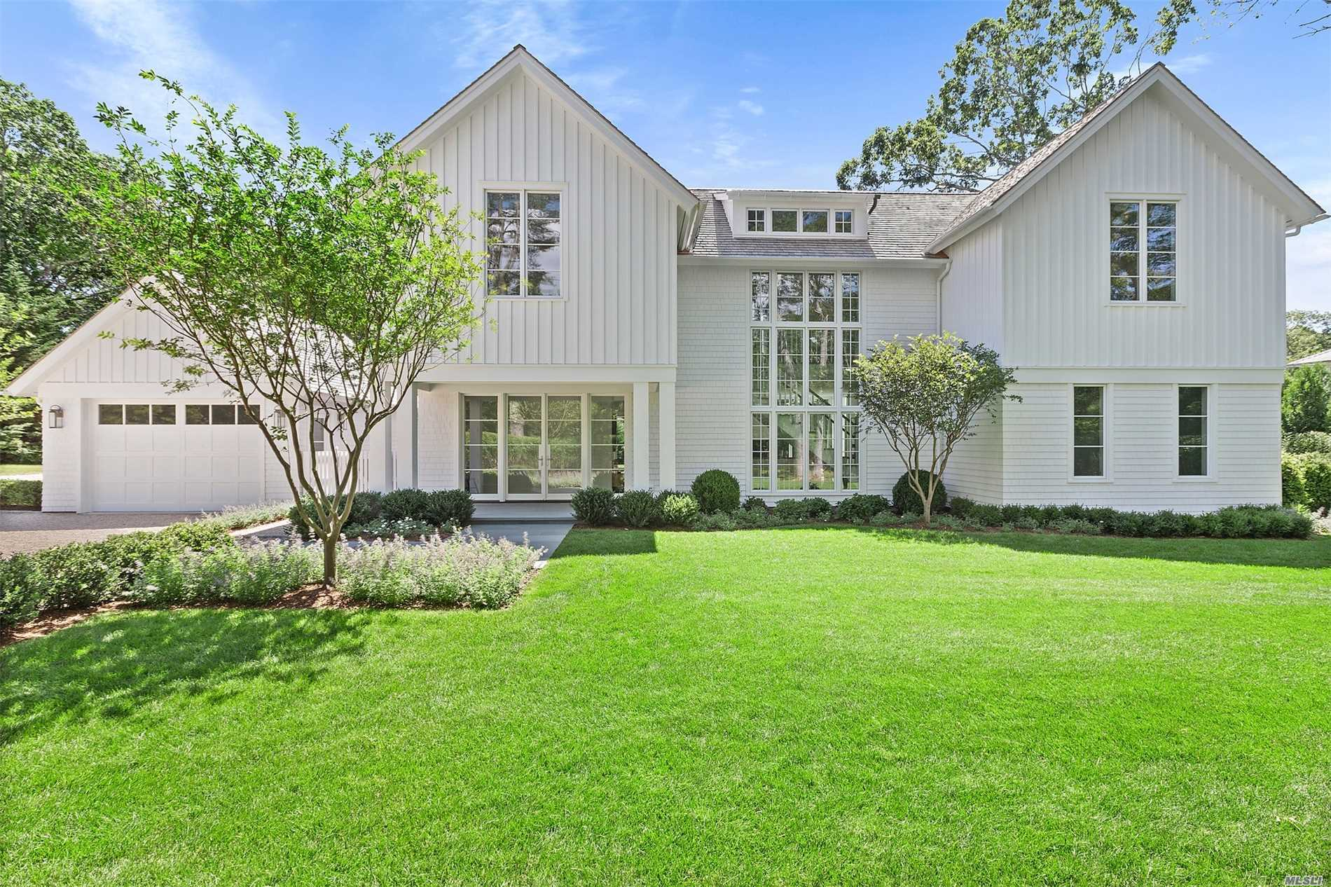 This stunning south-of-the highway, new construction, is nestled in the Georgica section of East Hampton Village. A collaboration of MAP Development and Fred Smith Architects, this exquisite home spans 4, 300 +/- square feet on three levels, boasting six bedrooms and seven and one-half baths. On the first floor, the large open, custom Henry Built kitchen, features only the highest quality stainless steel appliances.