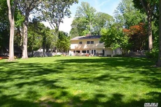 Must See to Believe! Best Value in Cold Spring Harbor for Move In Ready Home on Full Acre w/Beach/Mooring Rights! Nestled among Million $ + Homes, Ideally Located between CSH & Hunt.Villages! 3 Levels of Sunlit, Open Living Space. 2006 Roof, Siding, Windows & New Septic! LR w. Soaring Ceilings & Den w/ Wall of Windows, Both w/ Fireplaces. Bright Mstr. Bdrm has EnSuite/3 closets, Bdrm 4 w/ Powder Rm. can be Guest/Office Suite. Cold Spring Harbor Schools, Low Txs & Min. from CSH Train!
