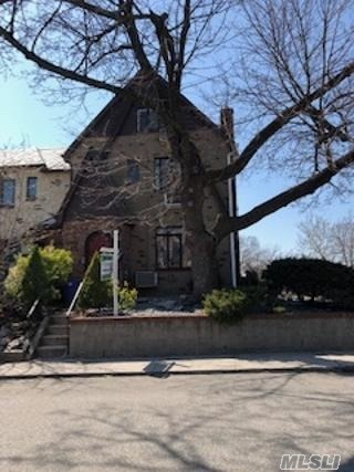 English Tudor R3-2 Zoned, Hardwood floors, Formal dining, dinette w/french doors to large patio w/retractable awning, Finished basement w/ sep entrance, gas heat sep hot waste, 5 bedrooms 2 full bath, 2 fireplaces Solid brick - walk to trans- lets make a deal