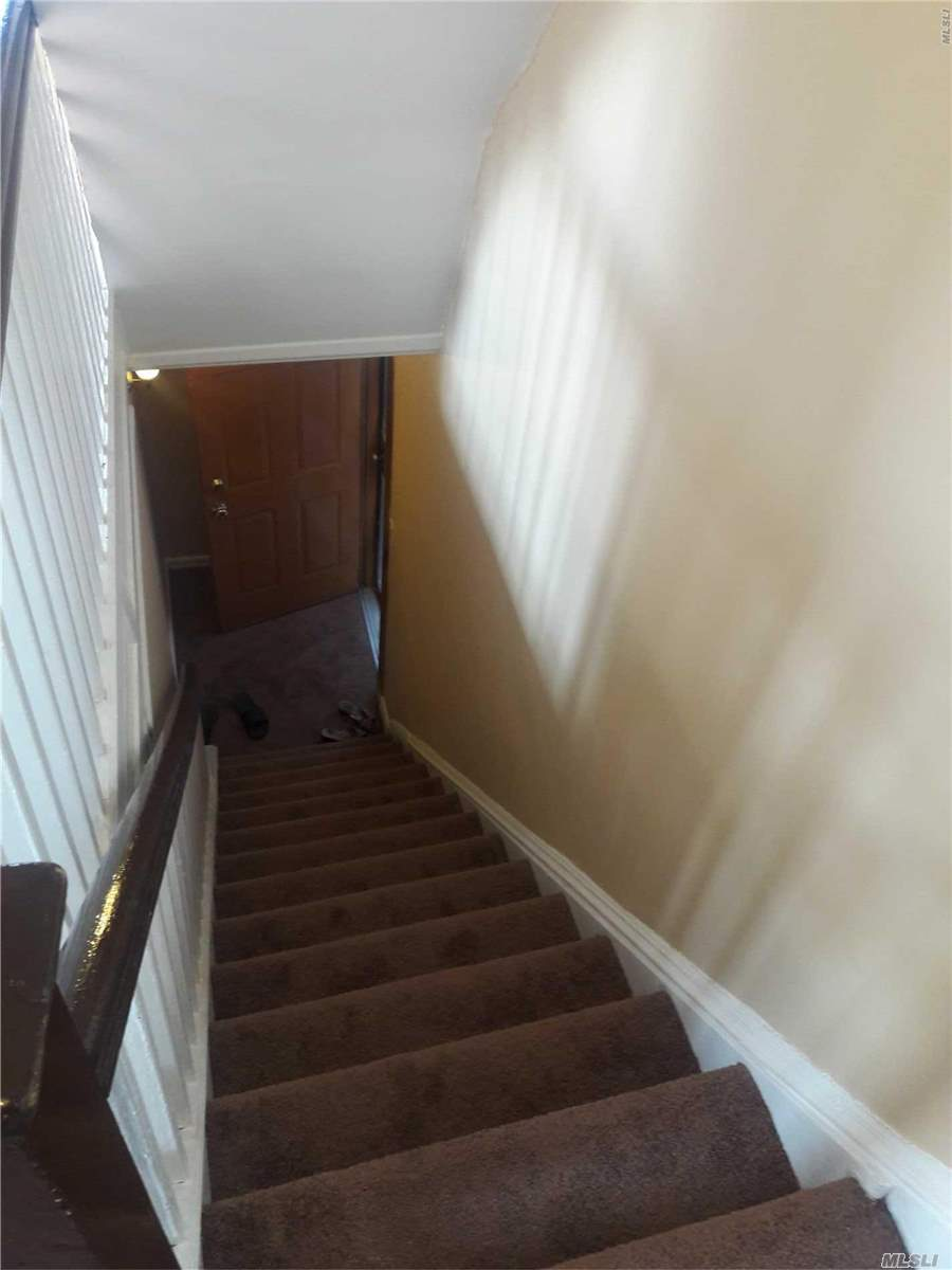 Lovely, super clean, one bdrm in duplex apt. Bonus room in the attic to be used for storage only. Large EIK.newly painted & carpeted. Super clean, flooded with sunlight. Easy street parking, private entrance, close to all
