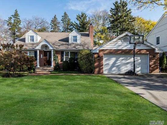 Beautiful updated Cape Featuring four bedrooms, oversized family room perfect for family gatherings with gas fireplace & sliding glass doors that lead to a private fenced in yard, formal living room with wood burning fireplace & updated kitchen.Convenient to LIRR, Parks, School and Shopping.