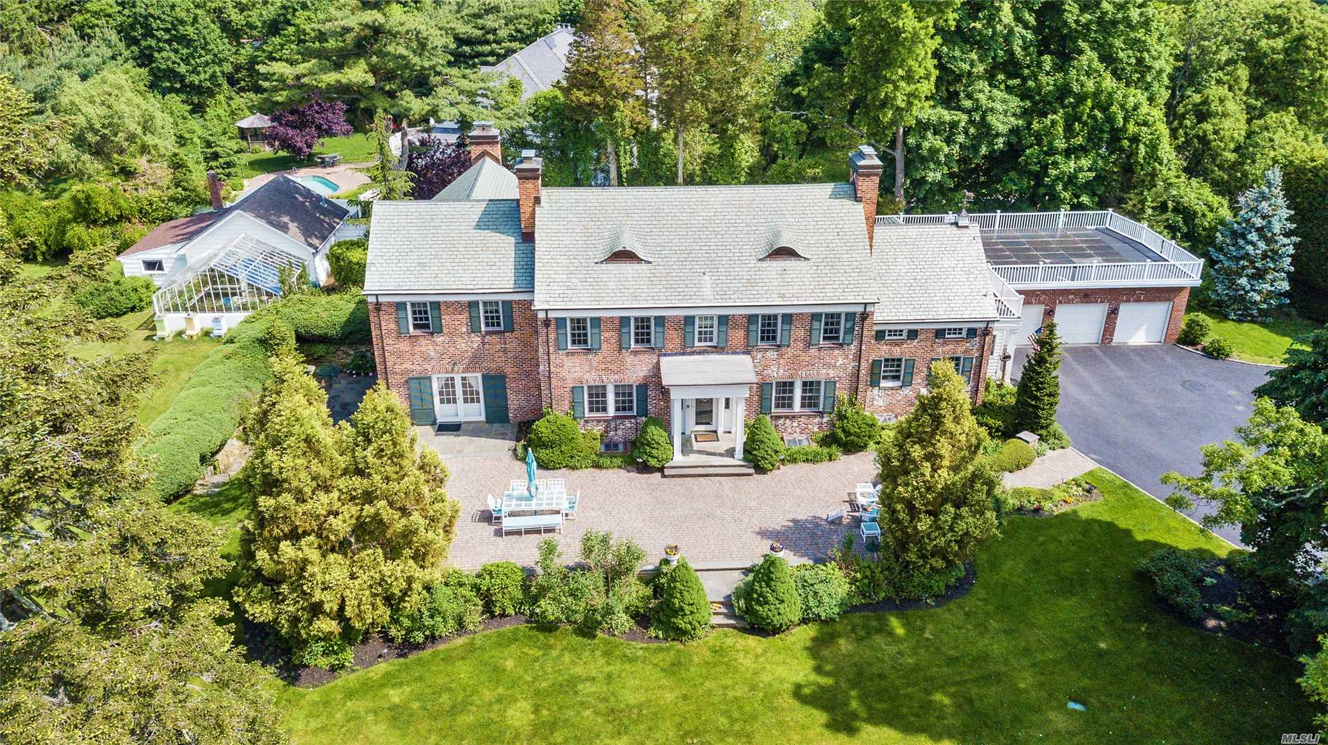 This Captivating Colonial Estate Is Located On A Quiet Cul De Sac. A Stunning Brick Manor Classic Home 4, 800 Square Feet Situated On Two Acres Surrounded By Beautiful Landscaping, Patios, Gunite Pool, Pond And Gazebo. Incredible Details Include Slate Roof, Copper Gutters, 6 Wood Burning Fireplaces, Solar Panels, Heated Three Car Garage, Green House/Barn W Outdoor Shower, Custom Eagle Historic Windows And More. See Separate Upgrade/Improvement Sheet. A Truly Unique And Special Home.