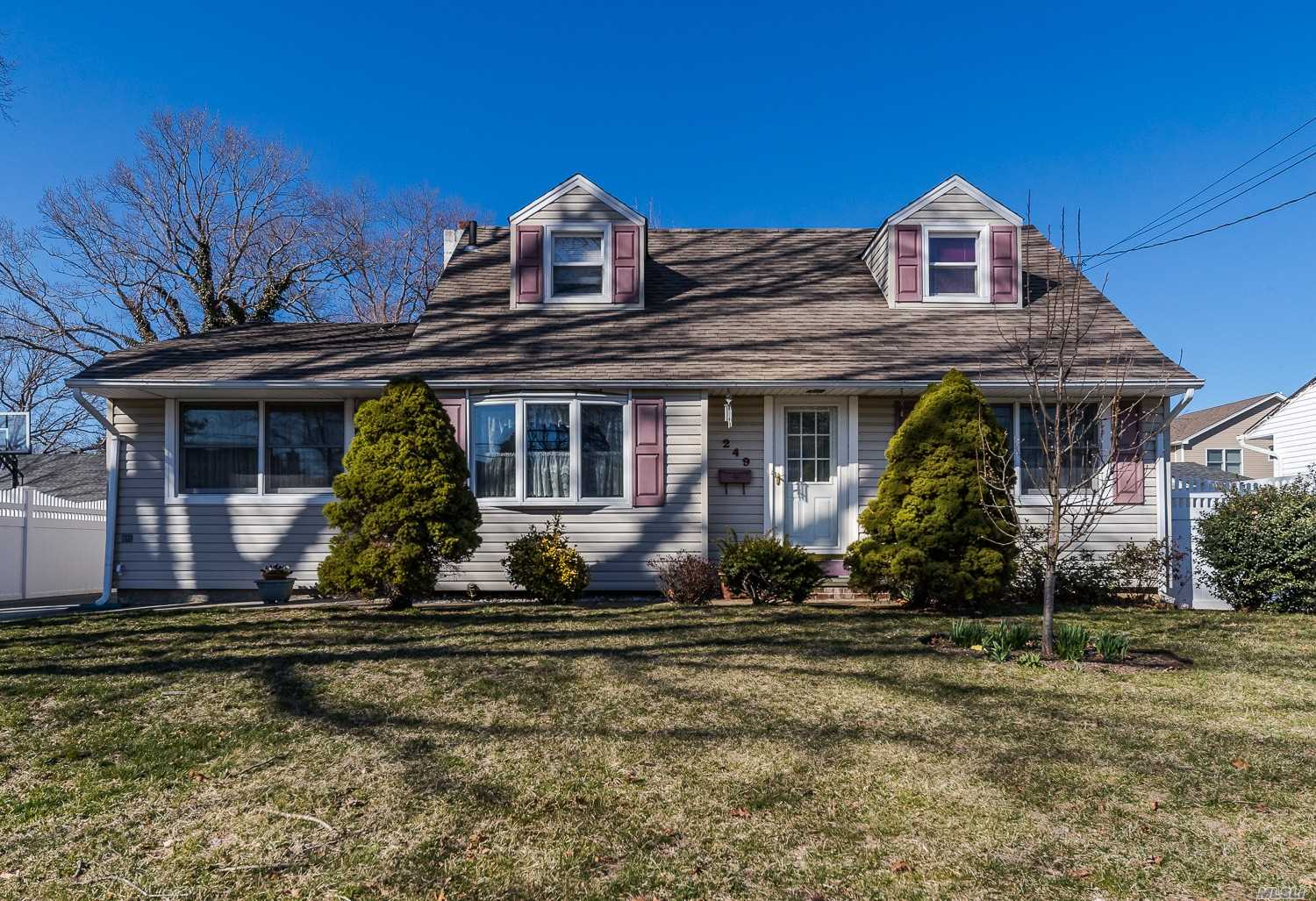 Large Expanded Cape In the Heart of Desirable Incorporated Village of Massapequa Park. Mid Block Location. Features Large Dining Room and Family Room. New Full Bath on lst Floor. Expanded driveway to 1 1/2 Car Garage, with nice yard. Taxes are being grieved, All Info should be verified. House is sold as is.  garage. House is sold as is.
