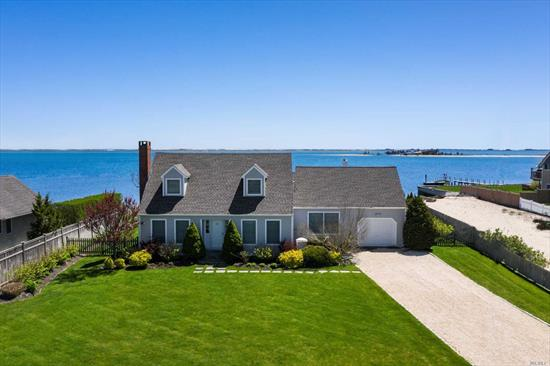 Enjoy expansive waterviews and a private sandy beach in the Hamptons at this renovated bayfront cape in Hampton Bays. Multiple decks and bulkheaded waterfront location providing a variety of scenic outdoor entertaining areas. The thoroughly modern chef's kitchen features imported marble and glass tiles as well as a generous center island. Luxurious details continue in both newly renovated bathrooms. Boaters will appreciate the boat slip with lighting, electric and water.
