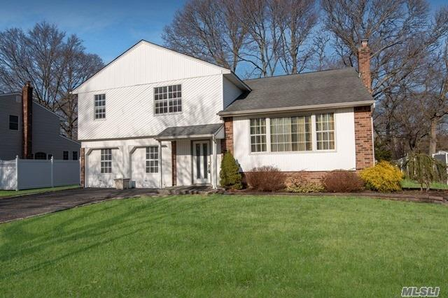 4 Bedroom, 2 Full Bath Splanch Colonial, Large Rooms,  Oversized Bedrooms, Master Bedroom W/ Full Bath, Formal Dining Room, Large Closets Throughout, Fireplace, Woodfloors & 2 Car Garage.