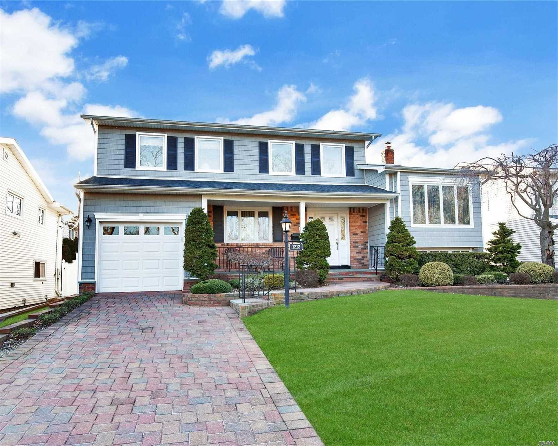The One You've Been Waiting For. Spacious flowing open floor plan. Diamond++. 5 BR Colonial/Split. All BRs up. Largest House On The Street. Expanded To Perfection. Hdwd Floors Throughout. . Radiant Htd Stone Floors. EIK With Granite Counter Tops, Stainless High End Appliances, Cherry Wood Cabinets. Basement Features A Pool Table Room With Bar, Play Room, Library/Office, Storage. Mid Block Location. Meticulously Maintained.