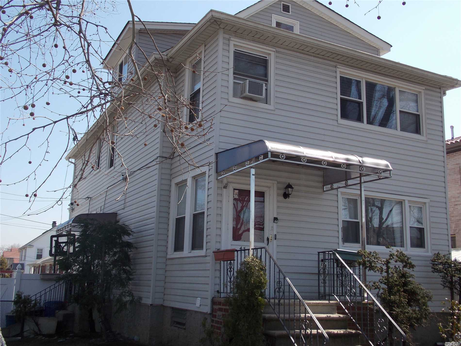 Detached legal 2 Family in SD#26 convenient location to all: LIRR, Bus (Q12, Q13, Q27, Q31, Q76), Highways & shopping. Totally updated in last 1-2 Years. New Boiler, New water tank, new electric, brand new 1 layer roof, siding, all windows, kitchen, 4 Gas heating zone, 3 electric meters, separate electric panel on each floor, fully finished large open loft in attic w/kitchen + bathroom, fully finished Bsmt. w/2 separate outside entrances + kitchen + bathroom. Pvt Driveway, Close to Northern Blvd.