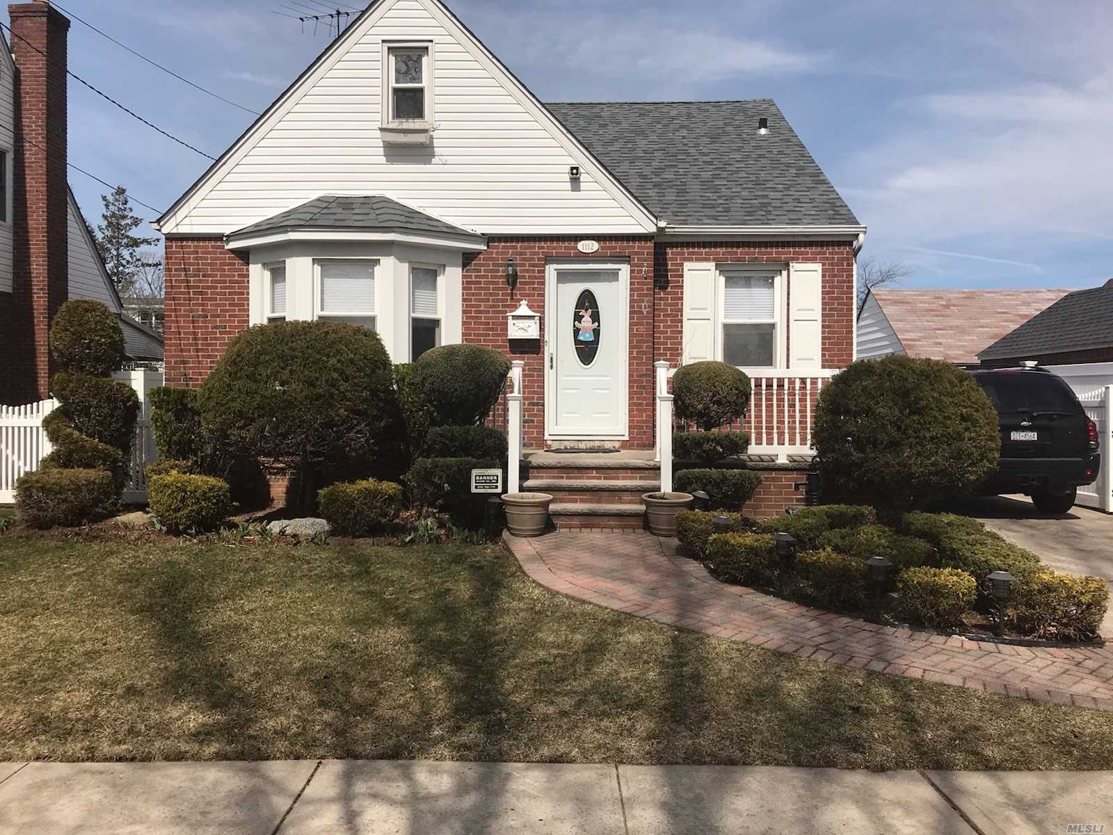 Great location, convenient to all shopping, transportation, stainless steel appliances, granite counter tops, hi hats, gas heating, new roof 2018, sprinkler system to enhance landscaping,  updated alarm system,  Franklin Square Schools