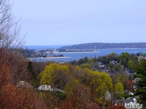 Comfortable Living In This 6 Bedroom, 6.5 Bath Home With Distant Water Views of Oyster Bay Harbour. Impressive Open Floor Plan, Master Suite On The First Floor With Fireplace And Deck. Spacious Gourmet Eat In Kitchen, High Ceilings, Wood Floor And A 3 Car Attached Garage. Conveniently Located To 25 A , Schools and Shops. Low Taxes!