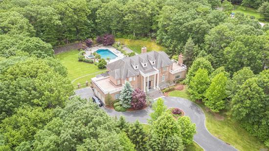 Grand and spacious brick colonial on a private 5.5 acres with pool, hot tub, bocce court, outdoor kitchen and 3 car garage. Picturesque views overlooking the 400 acre Planting Fields Arboretum in Upper Brookville. Enter into a gracious foyer and 10' ceilings on the first floor. 5 bedrooms including master suite with private outdoor terrace. Custom built 7, 000 square feet plus an incredible finished lower level featuring games, televisions, bar, gym and state-of-the-art Movie Theater.