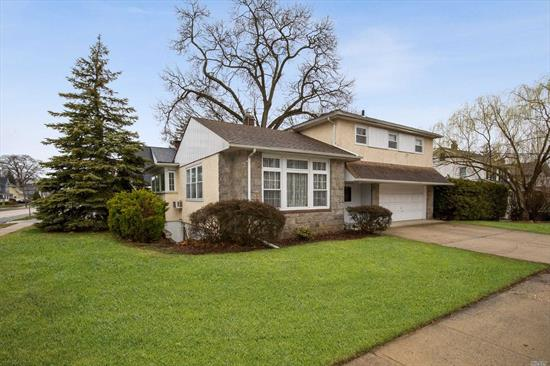 This Sprawling Split Style Home Sits on a large corner lot right in the heart of RVC & close to all . The 1st Floor offers a Living Room w /Vaulted ceilings and Large windows bringing in magnificent light. EIk and formal Dining Room .Second Level has 3 Bedrooms& Full Bath.Full finished basement offers more options for living space .2 car attached garage .Priced to sell !