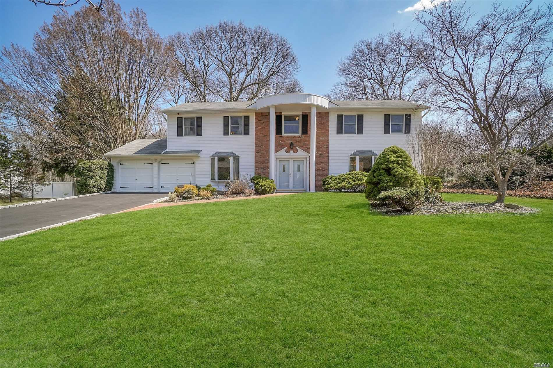 Dix Hills Vanderbilt Stately 4/5 Bedroom Colonial . Renowned Blue Ribbon Commack SD#10. Property lover's dream backyard!! Incredible Flat Park like property.. a rare find! Main level study and all generous sized rooms are some of the outstanding features of this home. New 2018/2019 updates include Preon CAC, Hot Water Heater, All new Top of the line appliances, Fisher-Pykel Gas Cook top, and More. Gleaming Wood Floors. and Stone Fireplace. A Rare home of distinction