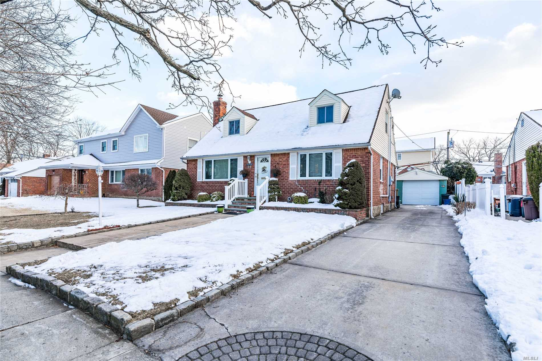 Updated Rear Dormered ( 1950 Sq/ft total w/o basement) 3Br, 3Bath Cape In Herricks Schools W/ Legal Extension For Full Dining Room And Large Family Room With Fire Place. Newer Baths And Updated Kitchen, 3 Zone Heat, 6 Zone Ductless A/C Cooling.