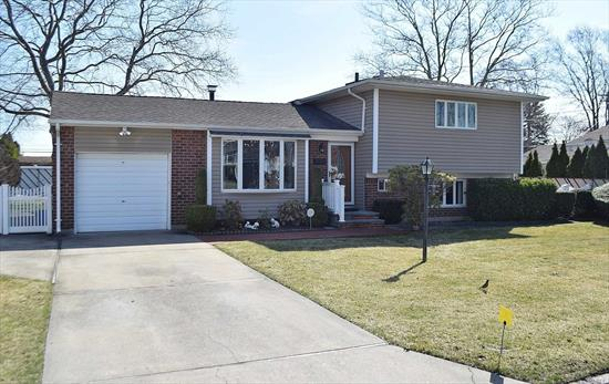 Beautifully Maintained 4 Bedroom/ 1.5 Bath Split Level Home W/ Garage On 75x100 Property. This Home Features Gas Heat, Cac, Igs. Anderson Sliding Glass Doors Off Kitchen, Alarm System & More!