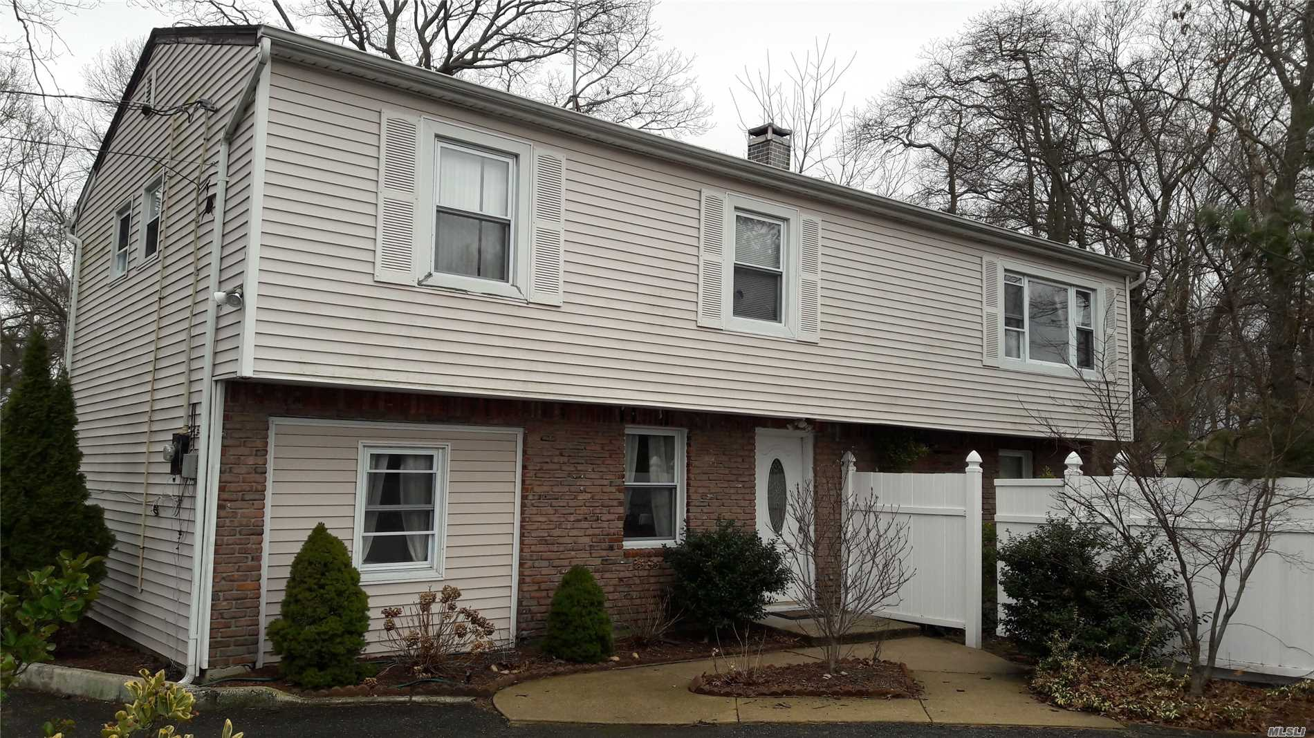 Come and look at this beautiful high ranch. Conveniently located near the Long Island Expressway. Entrance to property with proper permits is at the end Laurel Street. This lovely homes offers plenty of space an even room for mom. Don't wait, come and see before is gone!!