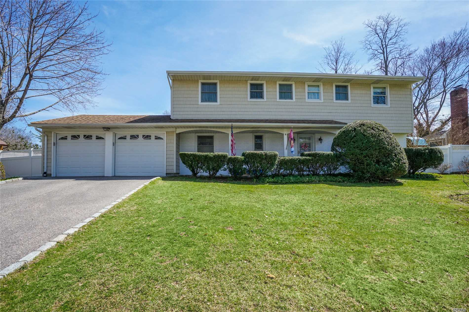 Mint Colonial !Quiet North Huntington Neighborhood! New Windows- New Baths- Updated EIK, New Oil Burner- Oil Tank Basement, Hardwood Floors , Living Room With Fireplace. Lovely screen porch/wood-burning stove; Private hedged yard Two Car Garage; IGS,