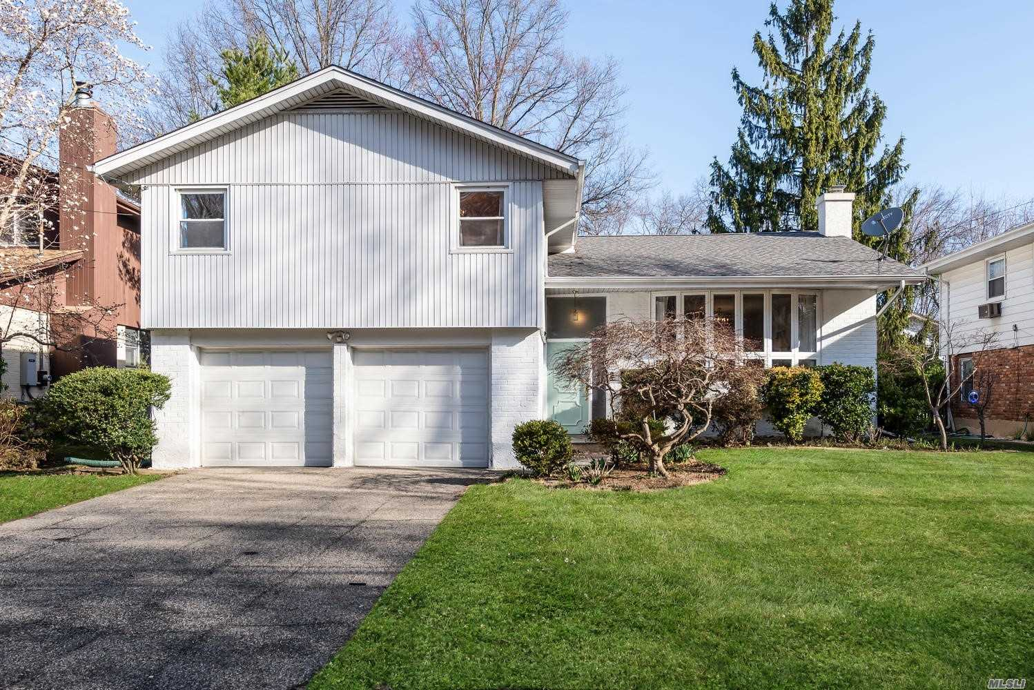 Sunny, spacious and well maintained Harbor Hills multi level home. 1st floor features living room with vaulted ceilings, updated eat in kitchen with stainless steel appliances, formal dining room and a large family room extension with fireplace. Hardwood floors thru out. Convenient to town and LIRR