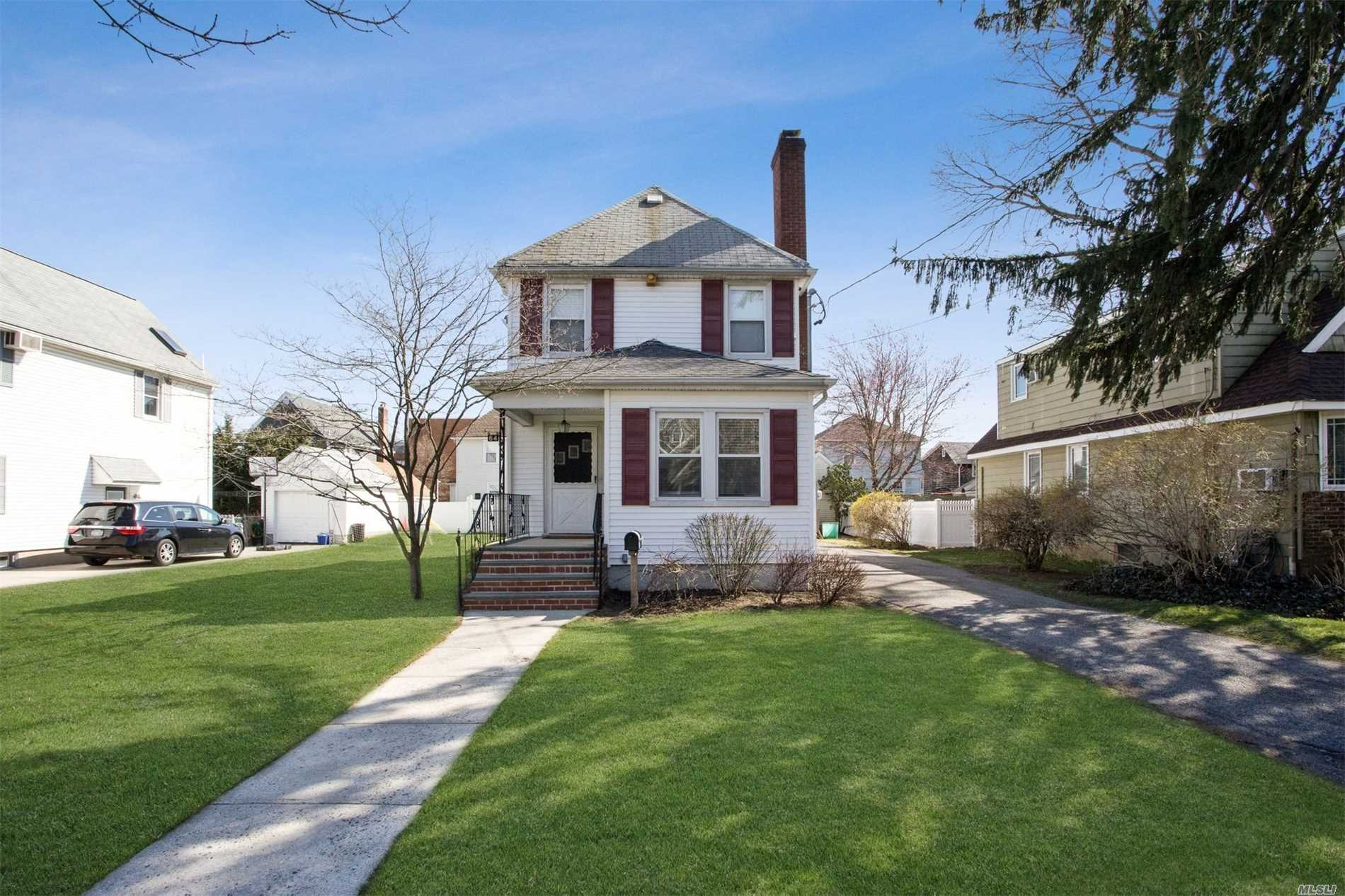 House Of The Week Price! Condition! Location! Malverne Classic Colonial Situated On A 60 x 100 Park Like Lot. This Home Boasts A Living Room With A Fireplace and Mahogany Inlaid Hardwood Floor. Formal Dining Room, Updated Eat-in-Kitchen, 3 Bedrooms and Full Bath. Close to All Schools & LIRR To NYC