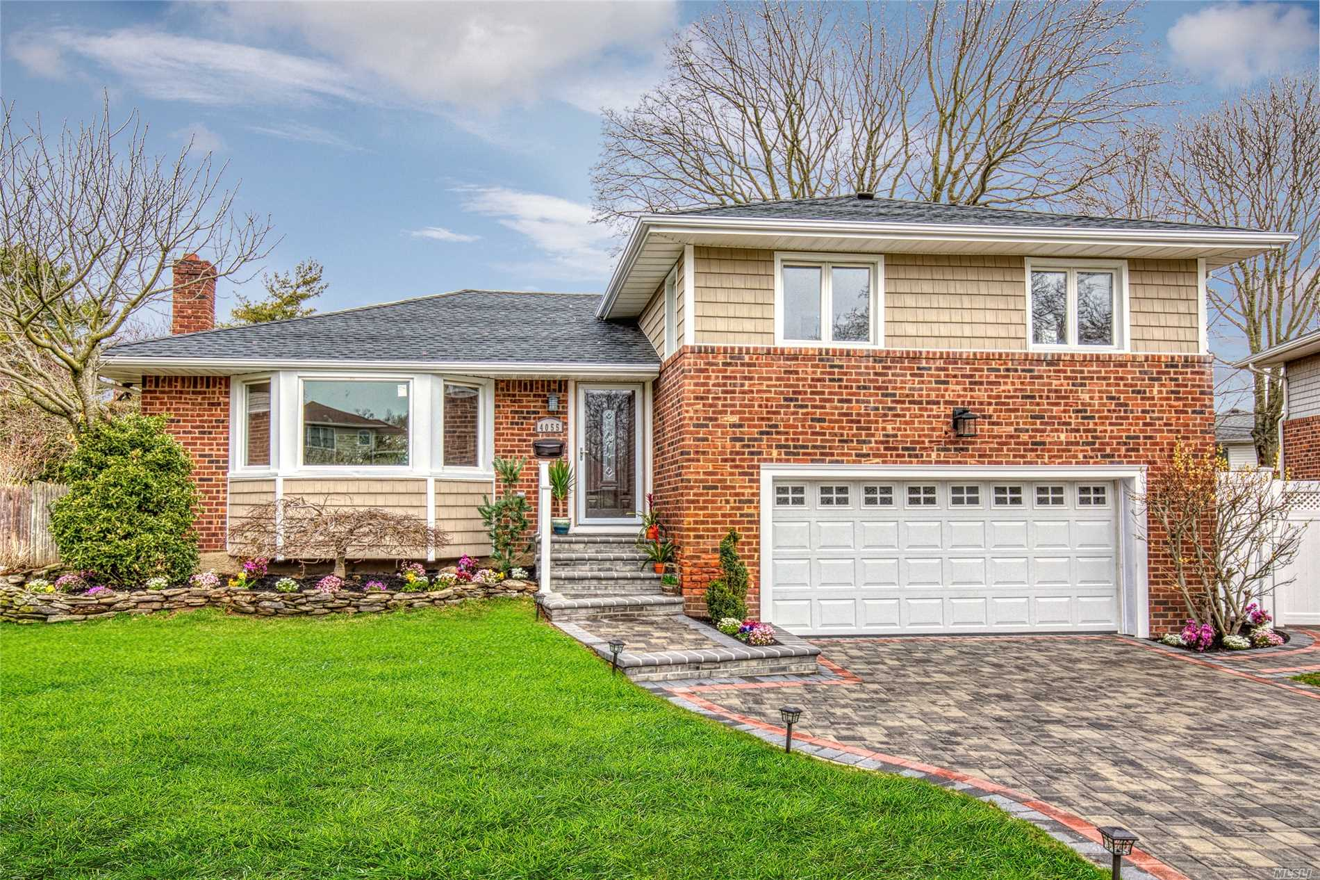 Amazing, designer inspired split located on a beautiful cul-de-sac. All renovated featuring open concept with vaulted ceilings, custom moldings, chefs kitchen, electric wall fireplace, gas heating, CAC, 200 amp electric, 2 car garage, finished basement, master suite with full bath, gorgeous paver driveway and front stoop, professional landscaping, private back yard with deck and paver patio. Truly just a wonderful home with amazing finishing touches.  Move in relax and enjoy for Summer!