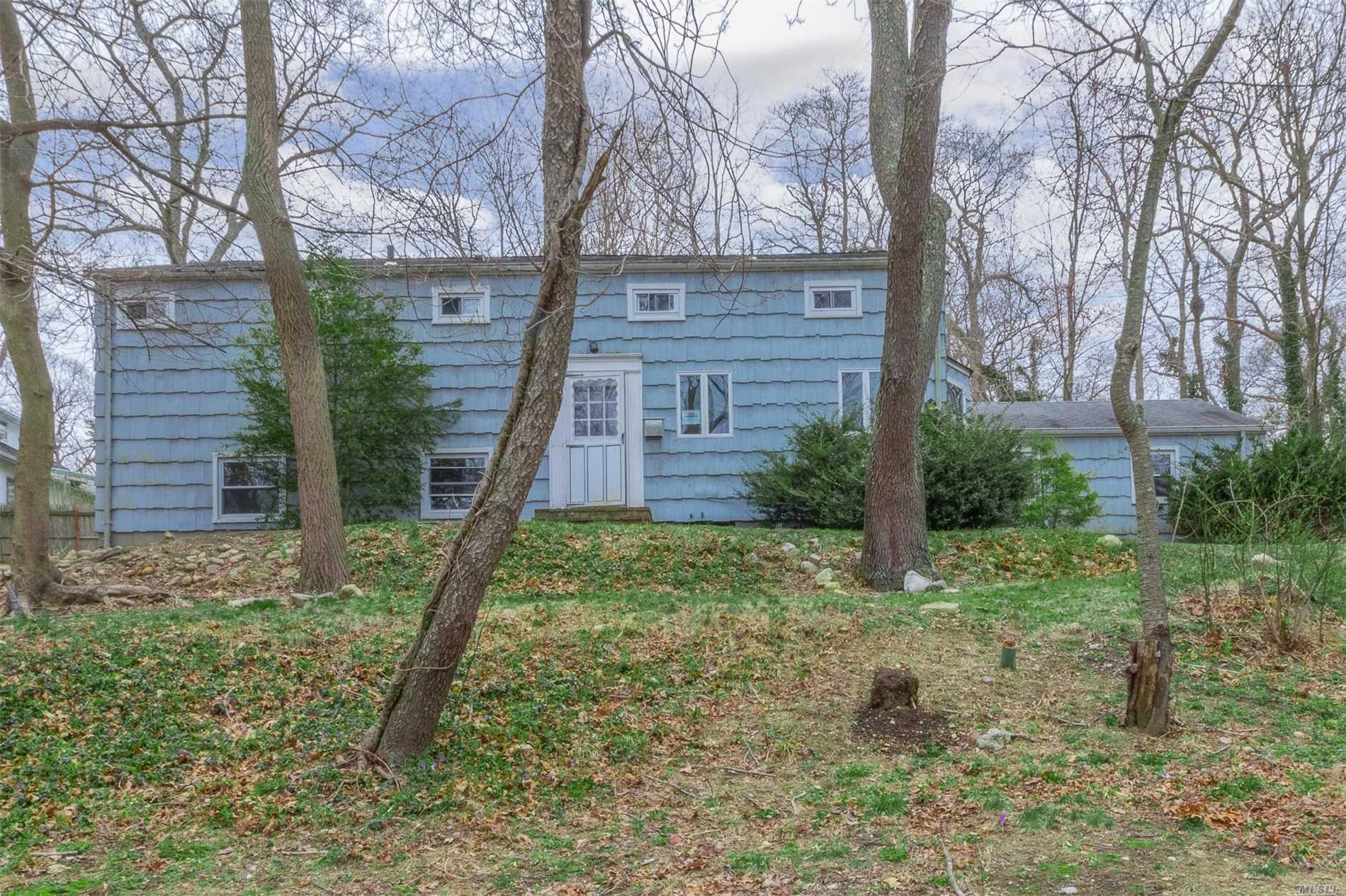 Large Split Level with 2 Car Attached Garage. Perfect for Large Family and Entertaining. Living Room Offers Wood Burning Fireplace and Hardwood Floors. Great Enclosed Patio. Large Bedrooms. Master Bedroom is Tremendous with Bedroom size Walk in Closet. Close to Sunken Meadow State Park.