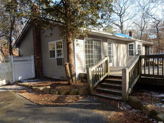 Lots of potential with this two (originally three) bedroom, 1 bath home with full basement and fenced backyard. Large living room with fireplace, dining room, sunny eat-in-kitchen, rear wood deck, koi pond. In need of work. Property being sold as is.