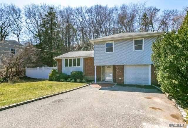 Sunny Spacious 4 Bedroom Contemporary Split. Open Floor Plan; Gas Fireplace; Den on Lower Level. Wonderful Private Backyard with Large Deck. Kitchen with New Stainless Steel Refrigerator Opens to DR. New Carpeting; Conveniently Located Near All.