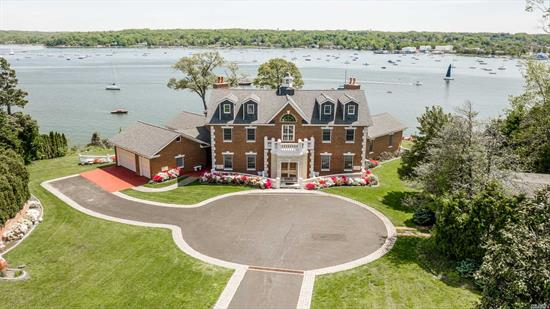 Centre Island, Stately Brick Colonial Style Manor Home, Perched On 3.26 Waterfront Acres w/ 250 feet of Sandy Beach .This Spectacular Property Features 180 Degree Panoramic Waterviews From Almost Every Room.The Spacious Interior Boasts, 10 Ft Ceilings, Radiant Heat, Marble Bathrooms, 5 Fireplaces, Custom Moldings & Architectural Details Throughout.The Home Also Includes A Separate 2 Car Gar & 800 Sq Ft Cottage W/Waterviews. Beautifully Landscaped Property Perfect For Entertaining W/Steps To Beach.
