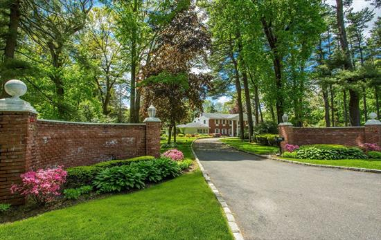 Gracious brick home sited on 2 magnificent acres in Old Westbury. Dbl story entry foyer opens to an oversized sunlit LR with white marble floors, banquet sized DR, LR with coffered ceiling, wood burning fireplace and French doors leading to the spectacular 2 acres. Other discerning features include a master STE with sitting room, designer fitted walk in closet, marble spa bath with 2 vanities, jacuzzi tub and separate shower. All rooms are generously sized.Possible 2nd master on main. Jericho SD