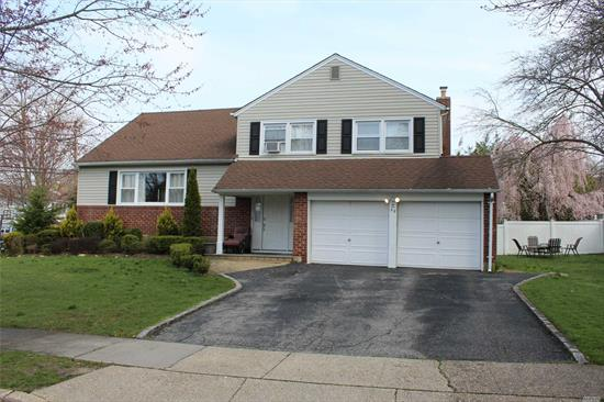 Location location location! Walking distance to train and more, Gorgeous kitchen, updated baths, wood floors, you couldn't ask for more! New AC and heating system This truly is a great house! Taxes successfully grieved!!Come see your new house before it's gone!