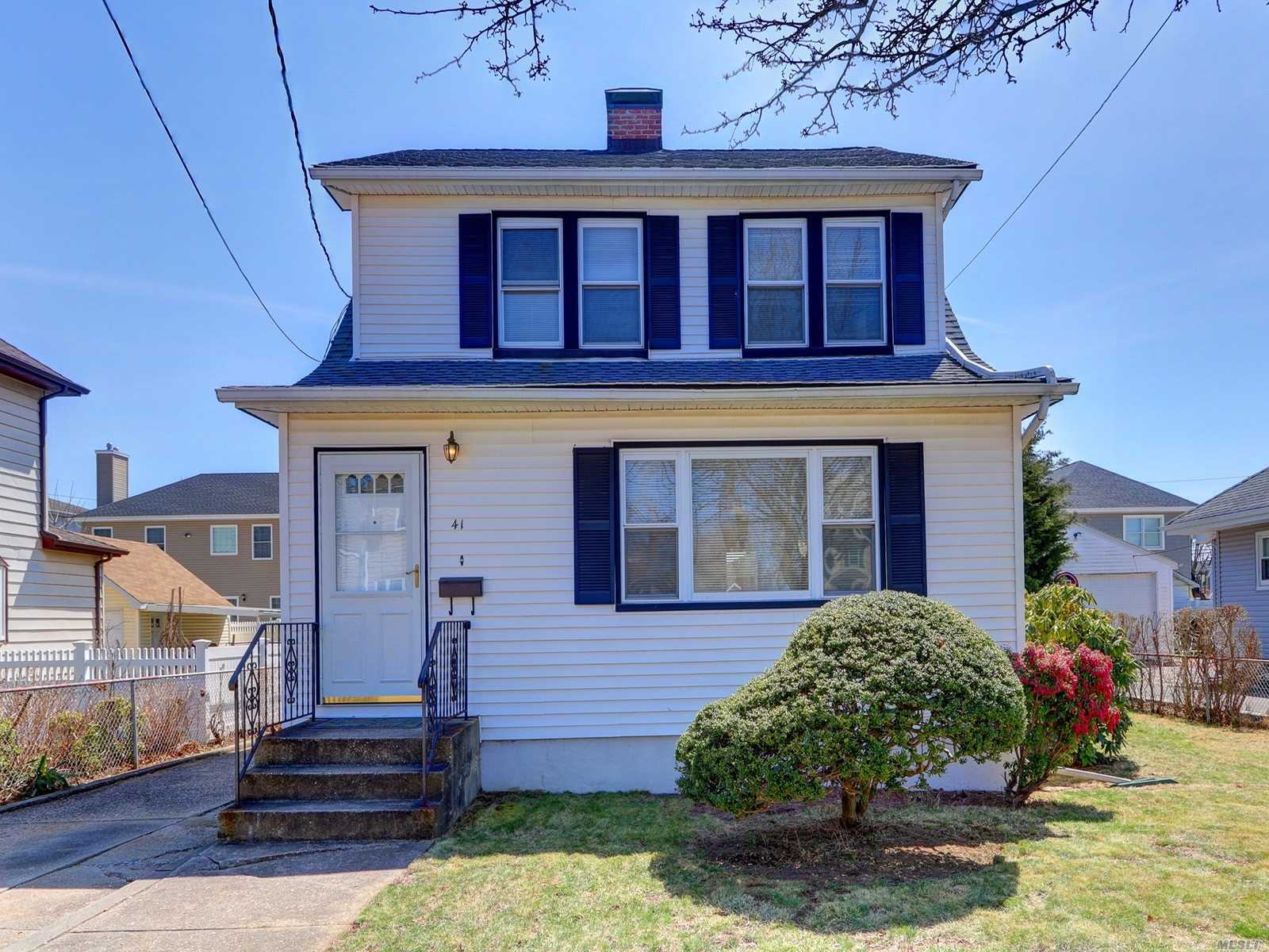 Turn key colonial in prime location with great curb appeal. Newer roof, siding, electric and gas boiler. Large living room with fireplace and new oak floors. Formal dining room with sliders to deck. New kitchen with white cabinets, quartz countertops and stainless steel appliances. Your choice to use as an office or mudroom off of rear entrance. Newer bathrooms too! Hardwood floors thru house. Basement high ceilings partially finished with laundry room. Solar panels on lease $71. a month.