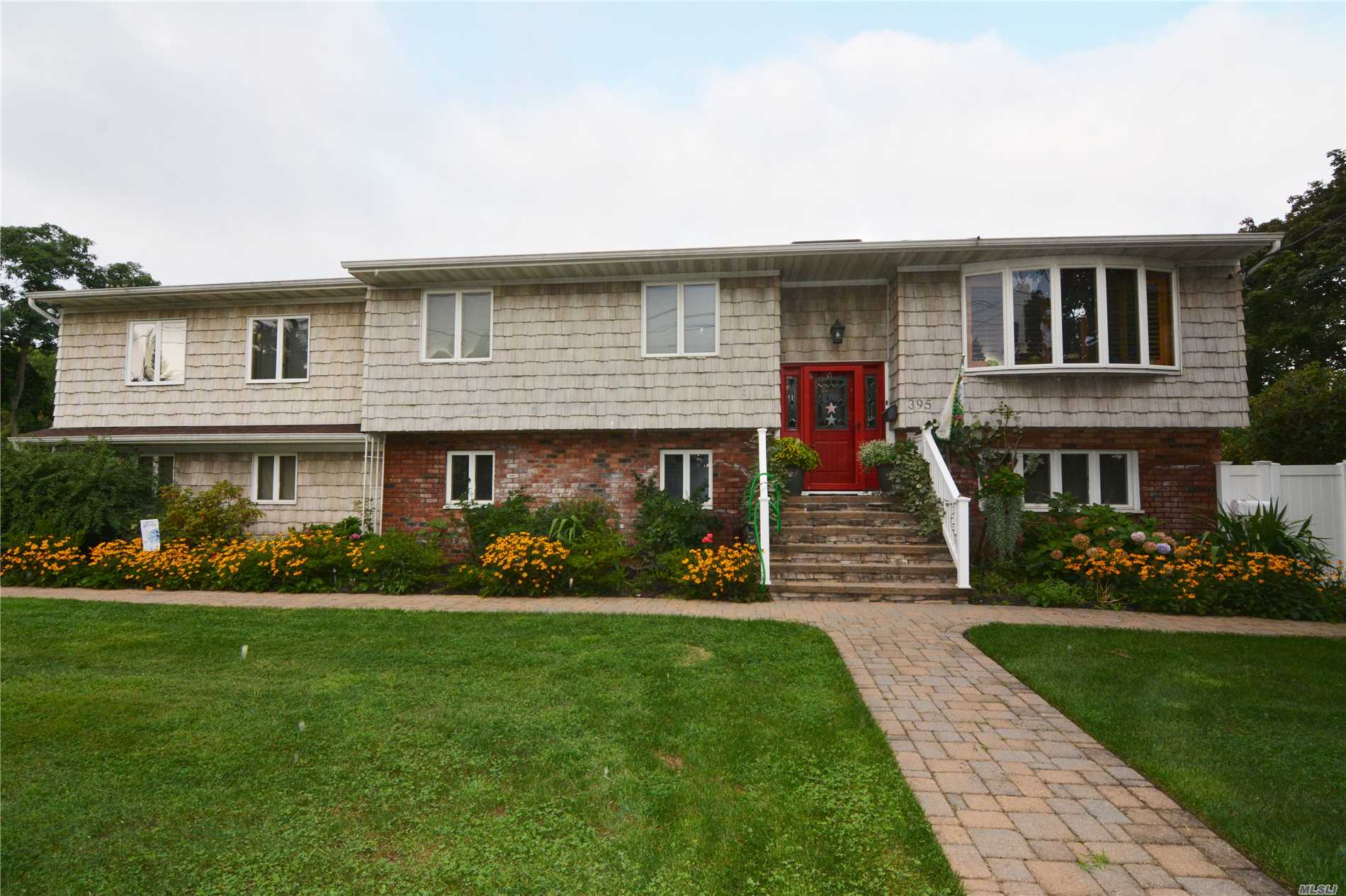 This legal (with permits) two-family offers room for all and then some! Spacious home with park-like grounds. Resort-like pool area. Large master bedroom with en-suite. Skylights and sun throughout. An absolute must-see!