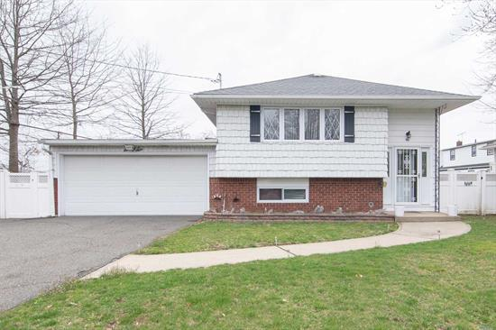 Come See This Hi Ranch.This Property Offers All The Space You Will Need. Largest Lot On The Block With Attached Two Car Garage. Three Spacious Bedrooms & Closets. Pull-down Attic, Living-room, Dining-room, Eat-In Kitchen & Full Bath On The Upper Level. The Lower Level Offers Two Rooms, Large Family-room, Full Bath, Garage Entry, Utility-room & Outside Entrance.