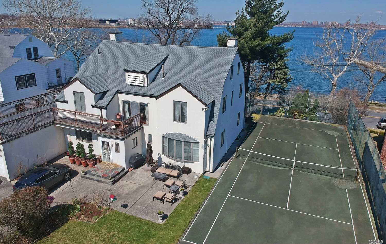 Large Center Hall Colonial with Waterfront and Bridge Views. 5 Bedrooms, 2 Full, 1/2 Baths . Huge size rooms. Open plan Kitchen/Family Room. Huge Elegant .Entry Foyer. 3 Fireplaces. One of a kind Home On 1/3 Acre Lot and the Only Private Tennis Court In The Community. 2 Car Attached .garage. Anderson Windows. Roof 4 Years Old, Grand Home Loaded with Old World Charm LOCATION!!!LOCATION, , , LOCATION !!!