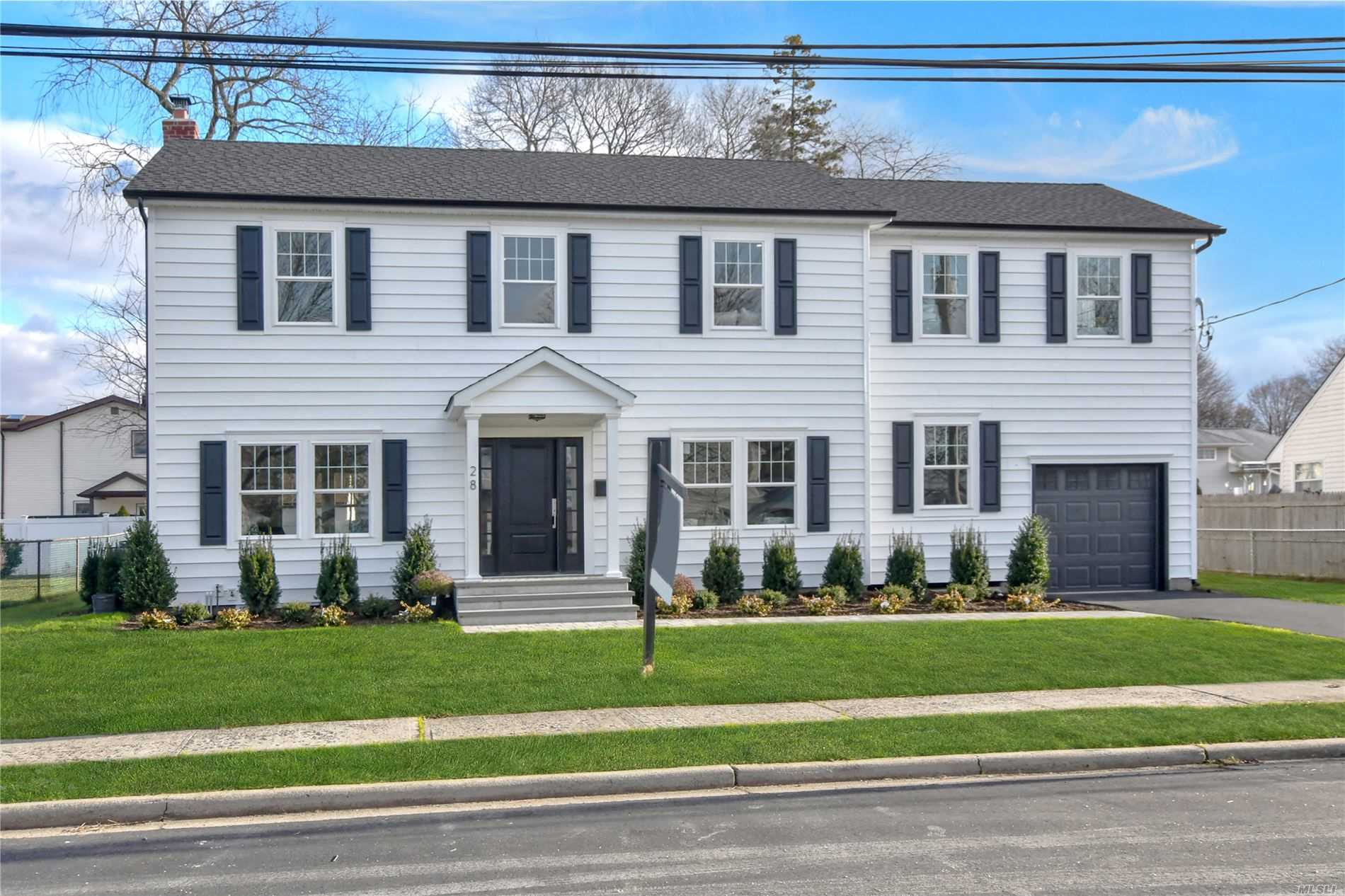Stunning top-quality rebuild 3000 plus sq.ft. Colonial w 2-story entry, open layout, 9'ceilings, hardwood floors, gourmet kitchen w quartz counters, access to new stone patio, spacious yard, master bedroom and bath w radiant heat floor & large walk-in closet, 3 additional bedrooms, laundry 2nd floor, conveniently located near houses of worship and more. Completion in May.  Move right in for Summer '19!!