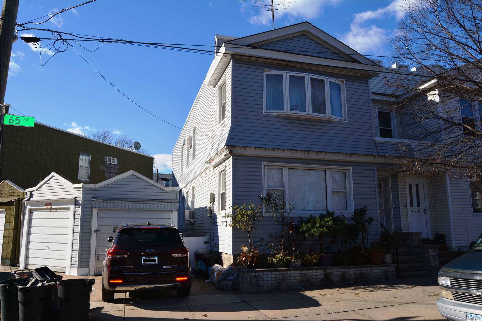 This is a legal 2 family home with a private, detached garage for 2 cars. It's a frame home in fair condition. Large fenced in back yard. Walkway to the backyard from the street. Basement is full grade and partially finished. First floor is renovated. 2nd floor needs some cosmetic work. Close to Fresh Pond Road, supermarkets, M train, restaurants and much more.