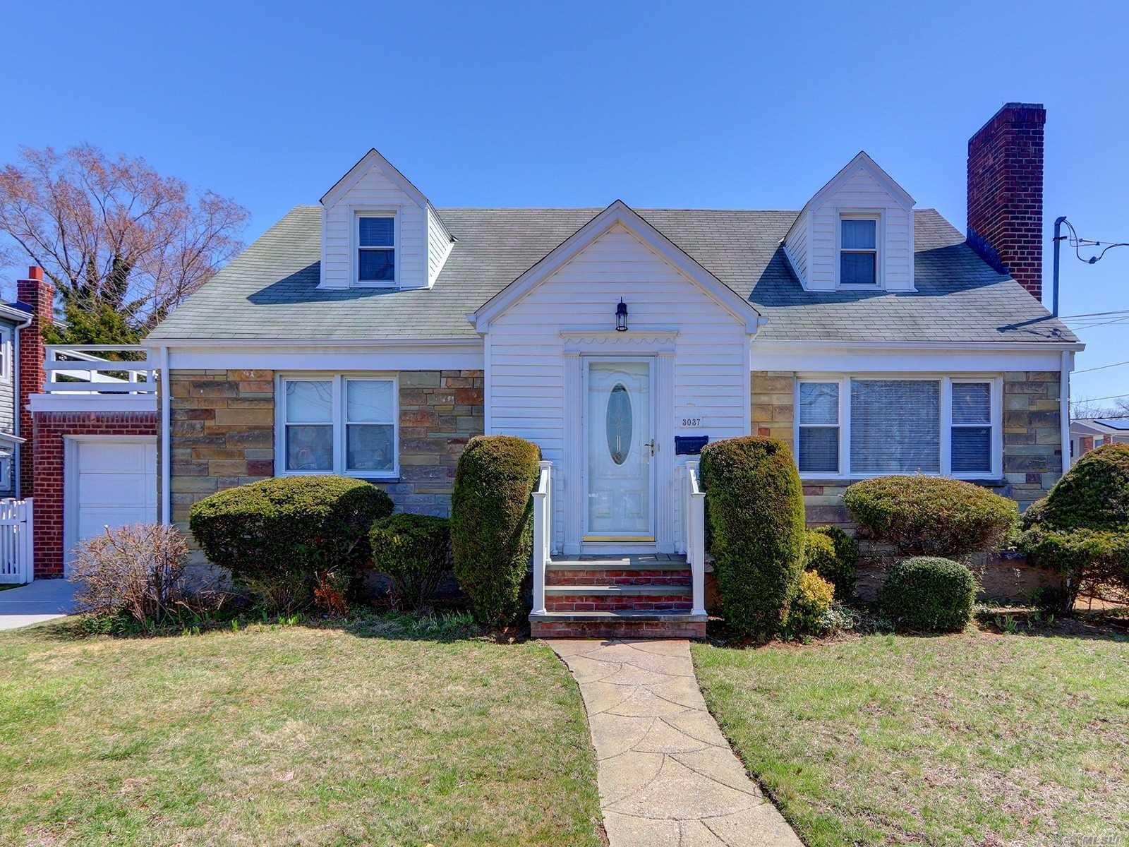 This lovingly and meticulously maintained custom wideline cape was built on oversized property. Immaculate throughout! Larger than most, this home even has a porch on the upper level--and a huge basement with high ceiling. Taxes are low, and no flood insurance is required. A must see!