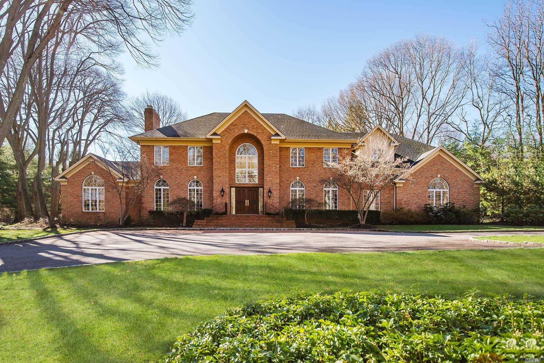 Stunning Laurel Hollow Custom Built Brick Colonial Set On 2 Beautifully Flat Landscaped Acres. An architectural Gem Featuring Floor to Ceiling Windows and Expansive Entertaining Spaces, Exquisite Wood And Marble Floors, Gourmet EIK, Five Bedrooms, 4 Full 1 Half Bath, Living Room, Office, 2nd Floor Playroom/Bonus Rm. Park-like Property With Beautiful Bluestone Patios And Room For Pool And Tennis, Cold Spring Harbor School District #2 Laurel Hollow Beach and Mooring Rights.
