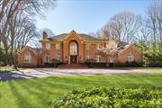 **NEWLY PRICED TO SELL &Taxes REDUCED $2800!! Laurel Hollow Custom Built Brick Colonial Set On 2 Beautifully Flat Landscaped Acres. An architectural Gem Featuring Floor to Ceiling Windows and Expansive Entertaining Spaces, Exquisite Wood And Marble Floors, Gourmet EIK, Five+ Bedrooms, 4 Full 1 Half Bath, Living Room, Office, 2nd Floor Playroom/Bonus Rm. Park-like Property, Bluestone Patios And Room For Pool & Tennis, Cold Spring Harbor School District #2 Laurel Hollow Beach and Mooring Rights.