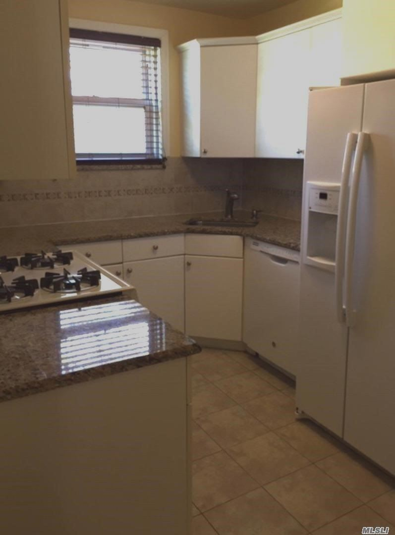Private Entrance E-Model, Hardwood Floors, Livingroom, Kitchen with Washer/Dryer, 2 Bedrooms & Full Bath, Full Size Attic for Storage, Close to Express Bus to NYC, LIRR & Buses to Subway.