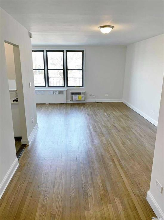 Board Approval required. Large L shaped studio fully renovated, bathroom and kitchen with 3 closets in an elevator building. White shaker cabinets with cron molding; 4 stainless appliances with dishwasher. All new walls, white subway tiles, marble floor, polished chrome fixtures. Refinished hardwd floors, new base moldings, casing & interior. New A/C unit, new windows mint condition. Temporary assessments of $80.00 til end of 2020 Close to subway and public transportation
