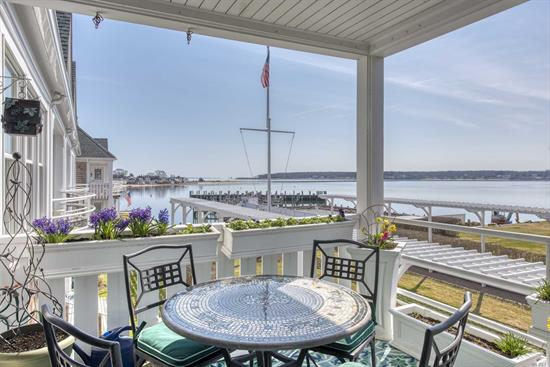 Exquisitely renovated corner unit with large water view deck. New upgraded heating & cooling, new windows, hardwood floors, wood burning fireplace, new baths, new kitchen, radiant marble tile floor heat in master bath, deck off kitchen, outdoor storage closet. Most square footage in complex. Private boat slip outside front door in protected harbor, pool, tennis courts & private bay beach all included. Easy stroll to all Greenport Village amenities.