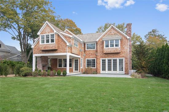 In the heart of Southampton village is this gracious compound with two single and separate lots set on a combined .45 acres. The just completed cedar shingled traditional main house has been masterfully re-built to the elegance of old world details and charm with todays modern amenities featuring 4, 500 +/- sq. ft. with custom arched staircase to access all three floors with six bedrooms, six baths with radiant heat warming floors, open floor plan kitchen with sub zero and wolf appliances, dinin